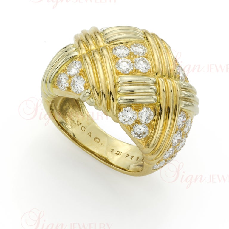 A classic wide band with a matching pair of gorgeous earrings from Van Cleef and Arpels! This jewelry set is crafted in 18k yellow gold and features a basket-weave motif pave-set with 6 carats of sparkling round diamonds. Displays gold stamp and