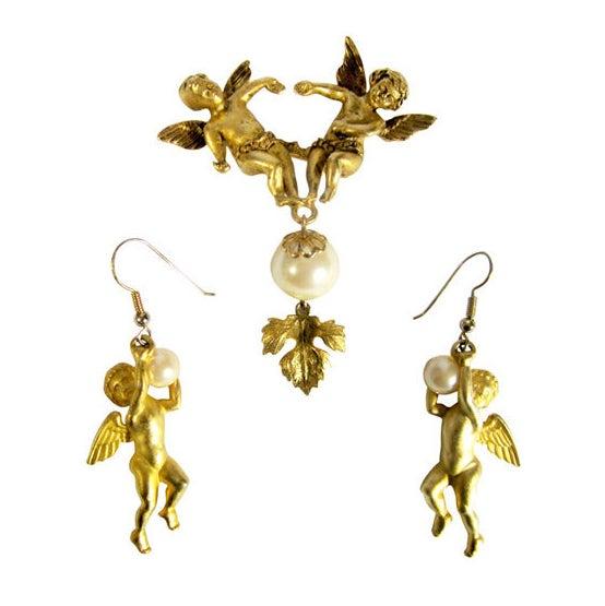 cherub brooch and earring set by jonette jewelry company