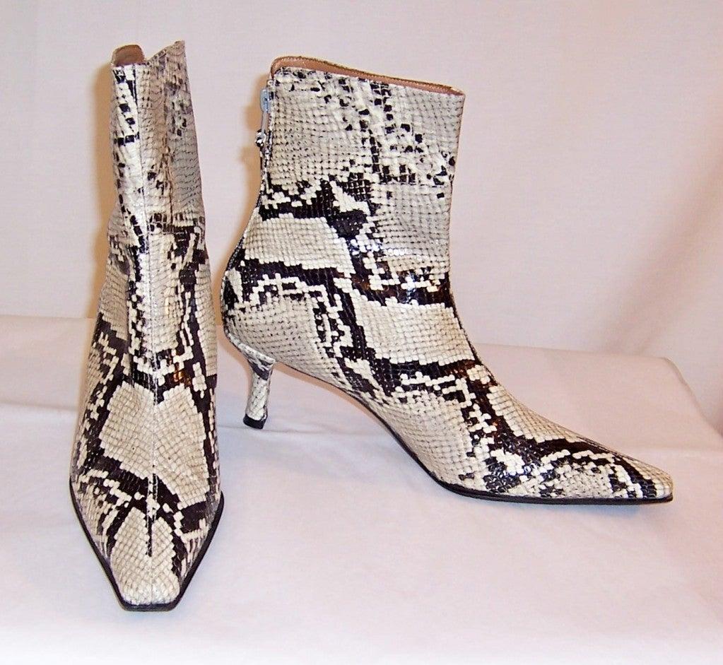 stuart weitzman s black and white snakeskin boots at