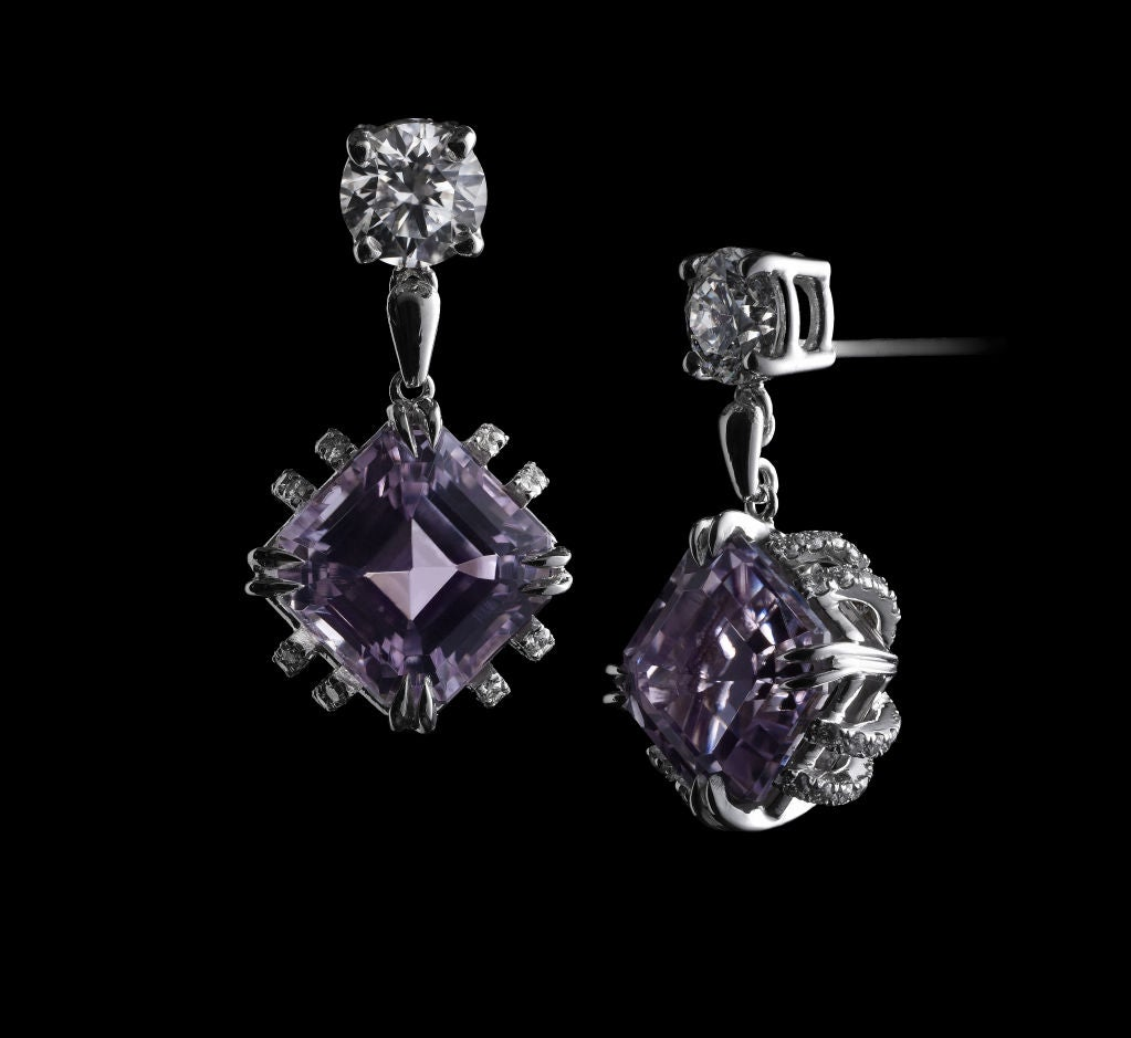 *Please contact us for more information on this piece or on creating your own Alexandra Mor custom Design.   A pair of Alexandra Mor earrings featuring Asscher-cut Kunzite weighing 4.70 carats which is suspended from a 0.42 carat round diamond.