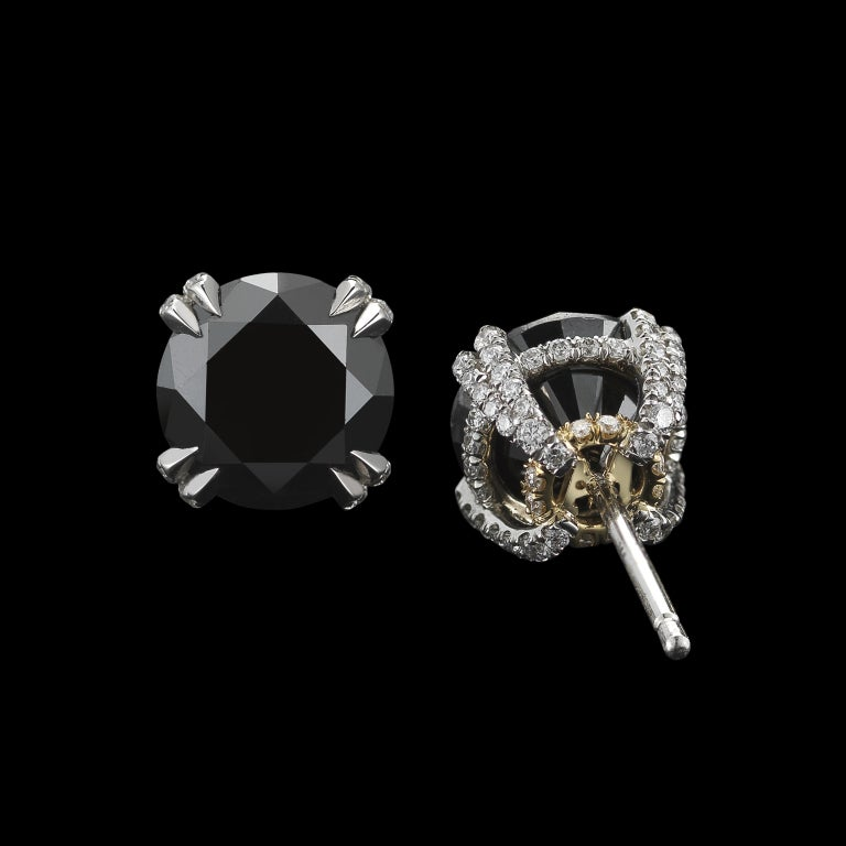A pair of Black Diamond studs detailed with Alexandra Mor signature 1 mm knife-edged wire, and featuring one hundred forty-four floating Diamond melee. Diamonds are set in platinum on 18 karat yellow gold with Alexandra Mor logo. Also available in