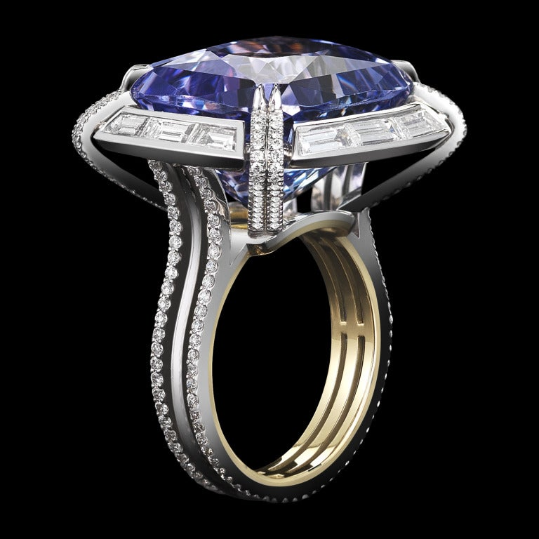 *Please contact us for more information on this piece or on creating your own Alexandra Mor custom Design.   An Alexandra Mor one-of-a-kind 25.78 carat cushion-cut Lilac Tanzanite ring set with Alexandra Mor signature details of 1mm floating diamond