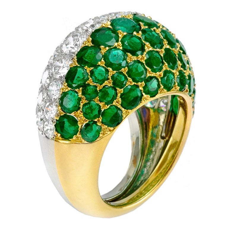 CARTIER An Emerald and Diamond Bombe Ring