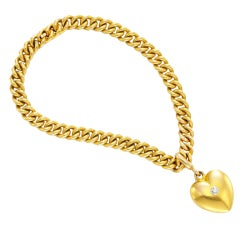 TIFFANY & CO. A Gold and Diamond Heart Charm Bracelet