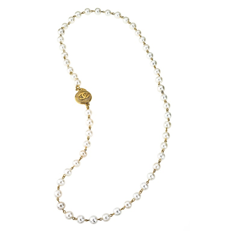 CHANEL LONG PEARL NECKLACE WITH CC COIN