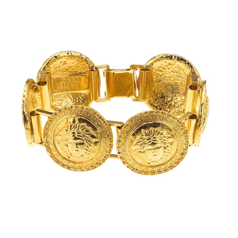 GIANNI VERSACE GOLD TONED BRACELET WITH 6 MEDUSAS 1