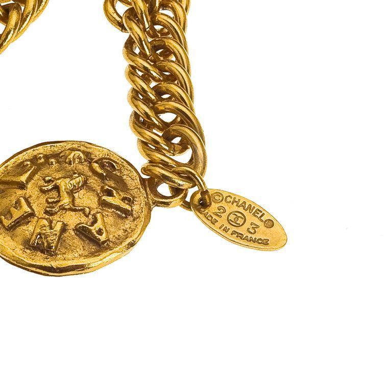 Chanel long sautoir necklace with lion motifs and Chanel logos.