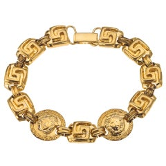 GIAANI VERSACE GOLD TONED BRACELET WITH MEDUSA AND GRECA