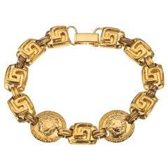 Gianni Versace gold toned bracelet with Medusa and Greca