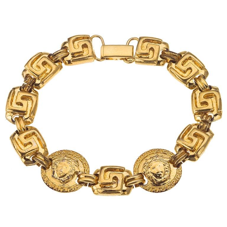 Gianni Versace gold toned bracelet with Medusa and Greca 1