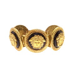 GIANNI VERSACE MASSIVE BLACK AND GOLD BRACELET WITH 5 MEDUSAS