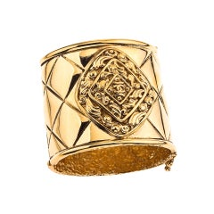 CHANEL MASSIVE GOLD TONED BANGLE WITH QUILTED DETAILS
