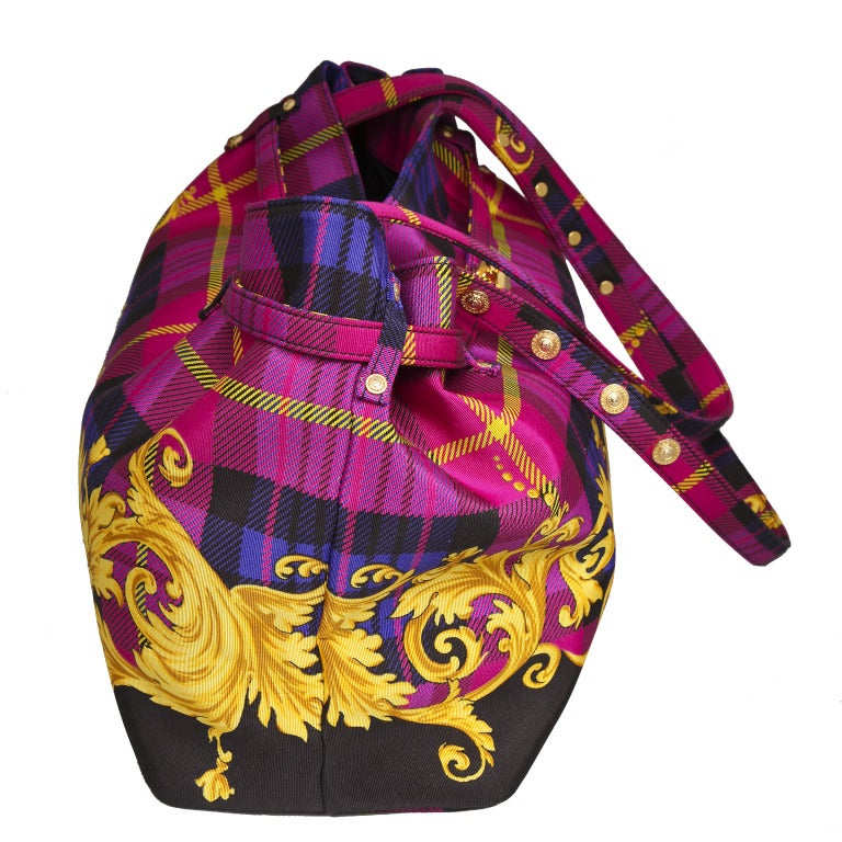 Versace Baroque print fabric bag.  Specifications: Height: 11, Width: 17, Depth 6 inches Handle Drop: 13 inches