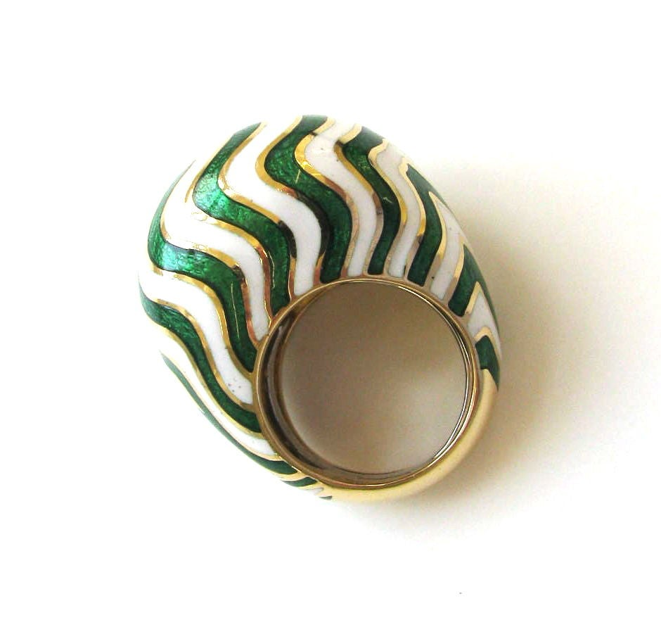 A substantial yellow gold and enamel ring by David Webb. The 18k yellow gold bombe ring with bright white enamel, punctuated by wavy lines of bright apple green guilloche enamel. A pretty ring for spring and summer. Sits 5/8