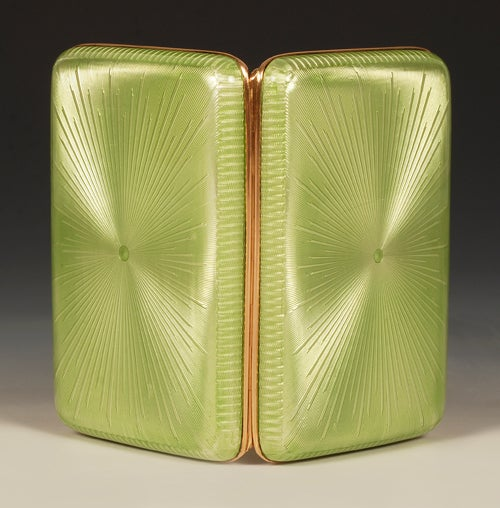 A Fabergé gold-mounted gilded silver and guilloché enamel cigarette case, workmaster Michael Perchin, Saint Petersburg, circa 1899-1903, with later scratched inventory number Z239. Rounded rectangular, enameled in translucent apple green over a