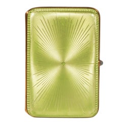 A Fabergé Imperial Russian apple green guilloché enamel case by Perchin