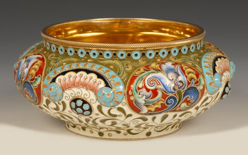 An impressive Russian gilded silver and shaded cloisonné enamel bowl, Feodor Rückert, Moscow, 1899-1908. The circular bowl chased with raised oval lobes, each lobe enameled with a colorful stylized tulip against an iron red ground alternating with
