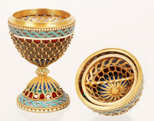 A rare Russian gilded silver and plique-à-jour enamel Easter egg and double egg cups, Moscow, 1908-1917. The double egg cups formed almost entirely of translucent plique-à-jour enamel, decorated with brightly-colored arched panels of translucent
