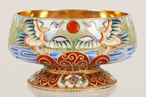 A Russian gilded silver and shaded cloisonné enamel master salt, Feodor Rückert, Moscow, 1899-1908. The exterior decorated with a continuous scene of pairs of birds alighting on a lake against a setting sun, alternating with stylized flowerheads,