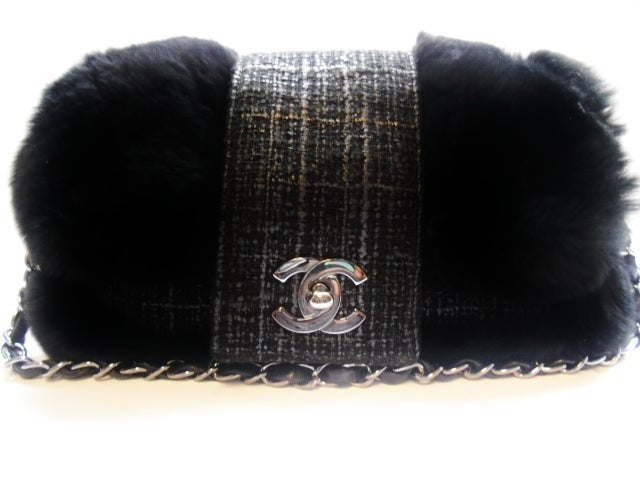 Beautiful tweed leather in gun/metal black in rabbit/chinchilla fur. leather and chain shoulder strap that could be used as a double or one long strap.  CC twist front closure, one inside zipper pocket. Chanel nylon lining. serial # 10117384. Dust