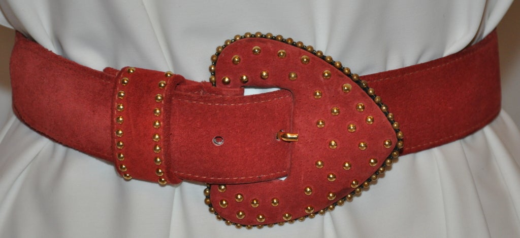 "Yves Saint Laurent gold studded brick-red suede belt measures 33 1/4 in length, 1 1/2"" in width, size medium."