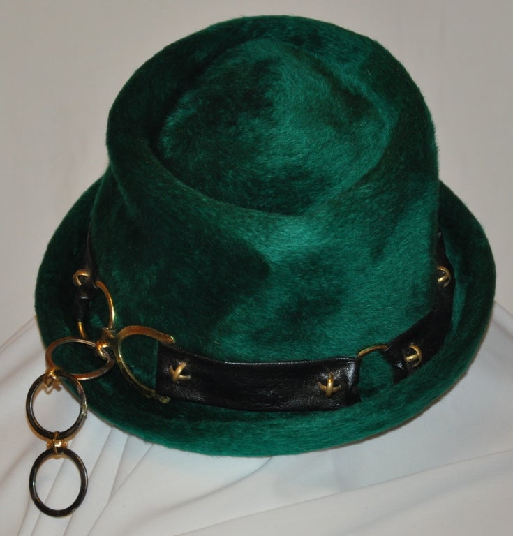 Yves Saint Laurent emerald green felted brushed wool hat has accents of black leather along with gold hardware.