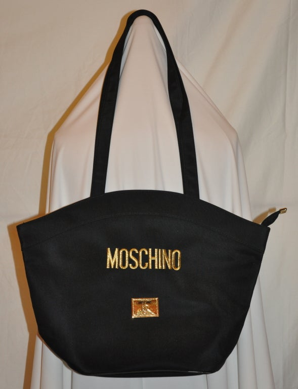 "Moschino Black nylon shoulder bag measures 12 1/4"" in height, 17"" in width, depth measures 5 1/4"".