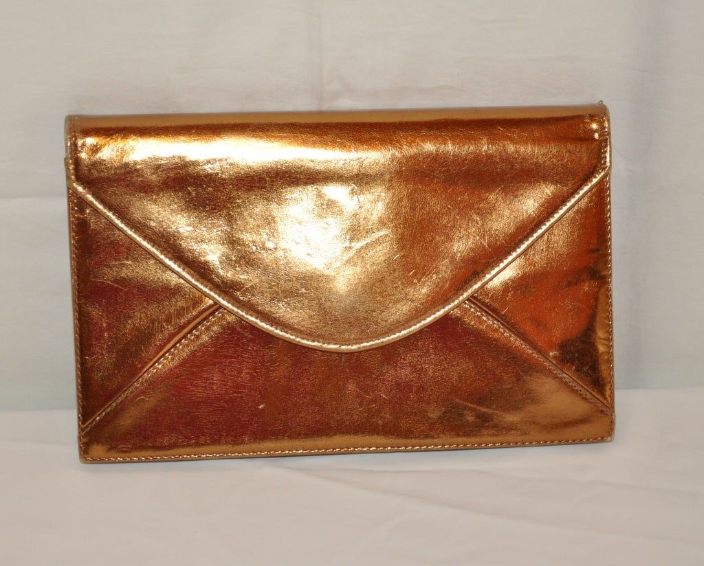 saks fifth avenue metallic bronze leather clutch and shoulder bag for sale at 1stdibs