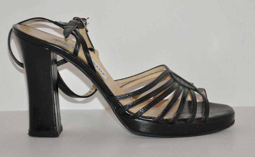 "Dolce & Gabbana black sandals has chunky heels which measures 4"" along with a slight platform front measuring 1/2"". Sandal is size 38 Italian, American 8 regular."