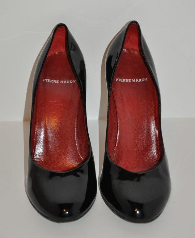 "Pierre Hardy Black calfskin patent leather pumps has that ""Mary Jane"" look. Heels measures 4"", size is 39 1/2 Italian, American 9 1/2 regular."