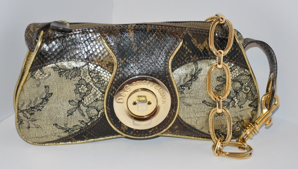 Dolce & Gabbana multi-embossed calfskin bag of lace and lizard are in combinations of metallic-gold with embossed lace print. The edges are with gold-metallic gold calfskin. Handles are of gold hardware which can be adjusted. Fully lined with two