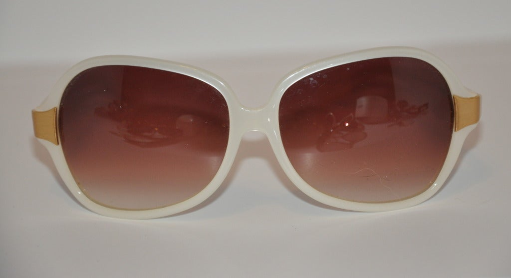 Oliver Peoples pearl and gold hardware accents sunglasses measures 2 1/4