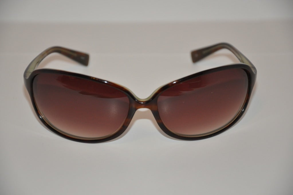 Oliver Peoples tortoise shell frame sunglasses measures 1 7/8