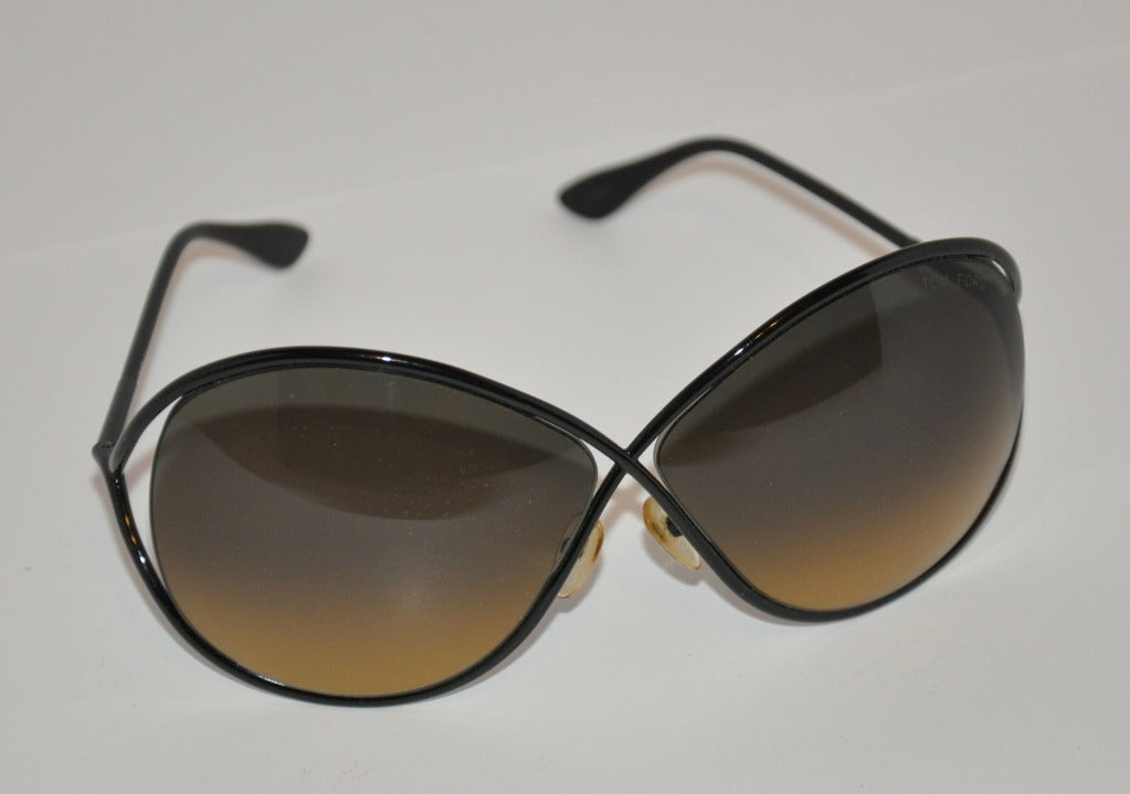 """These """"limited edition"""" Tom Ford black sunglasses are simply elegant. Height measures 2 1/2"""" and 5 1/2"""" across, or 7 1/4"""" in semi-circumference in front. The sides are 5"""" in length. Measuring from tip-ends to tip-ends is 16"""".     Sunglasses are"""