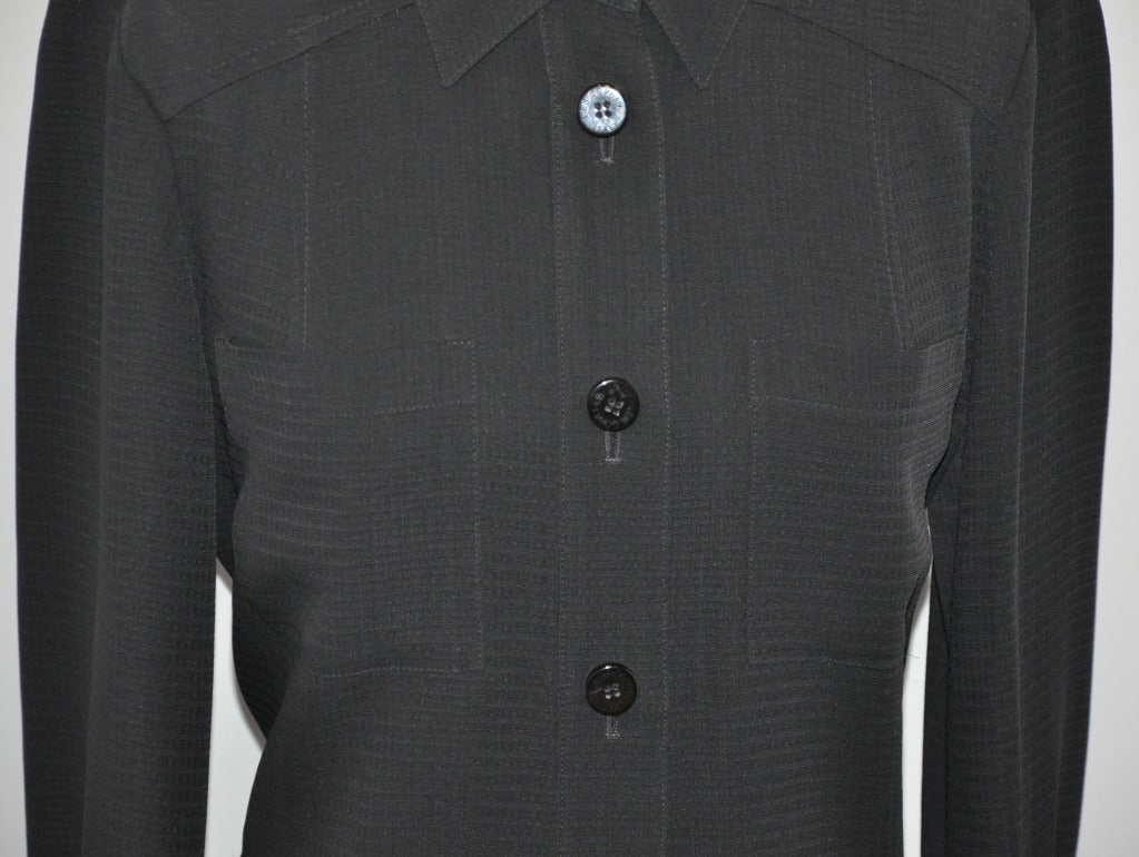 """Les Copains black seven-button-down shirt-dress measures 39"""" in length in back, 36"""" in front. There are two breast patch pockets in front. The sleeves measures 25"""" (including 2 1/2"""" cuff). Cuff's circumference measures 8"""