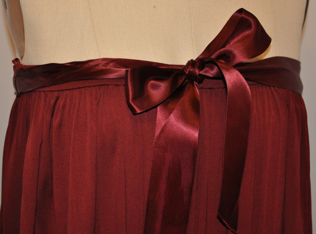 Julio's wide-band full-cut strapless evening dress in deep Burgundy gives the option to wear as a full-cut evening skirt if desired. There's a 1 1/2