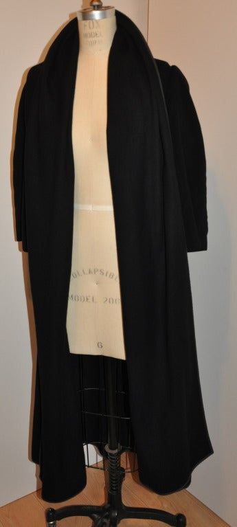 """Comme des Garcon """"Blue Label"""" black cashmere and wool blend has detailed silk ribbon finishing all edges and the interior stitching.    Shoulders are padded with an oversized shawl collar measuring 23"""" in height to used as a hood if desired."""