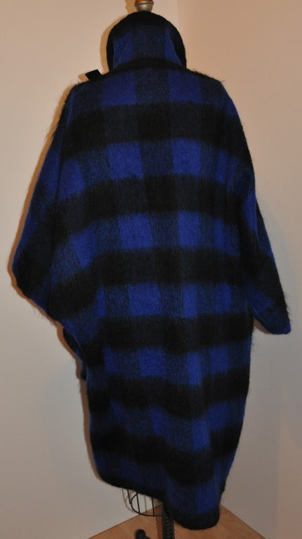 This wonderfully light-weight Yves Saint Laurent mohair navy and black coat-cape has a simple  double