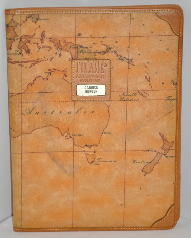 """Alviero Martini """"Map"""" Note-pad cover is trimmed with calfskin leather. Front cover has glod hardware plated with """"Candice Bergen"""" engraved within. Original tags still attached.    Length measures 10"""" when closed, 19"""