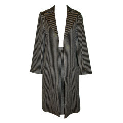 Possible Norman Norell Metallic black & Gold stripe suit