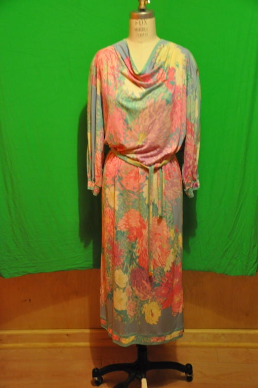 Leonard, of Paris, Multicolored '70s Leonard draped dress so so wonderful to have for any occasion. The front has a beautifully draped neckline and slightly dropped shoulders. There are cuff detailing along with the detailing on the hemline.