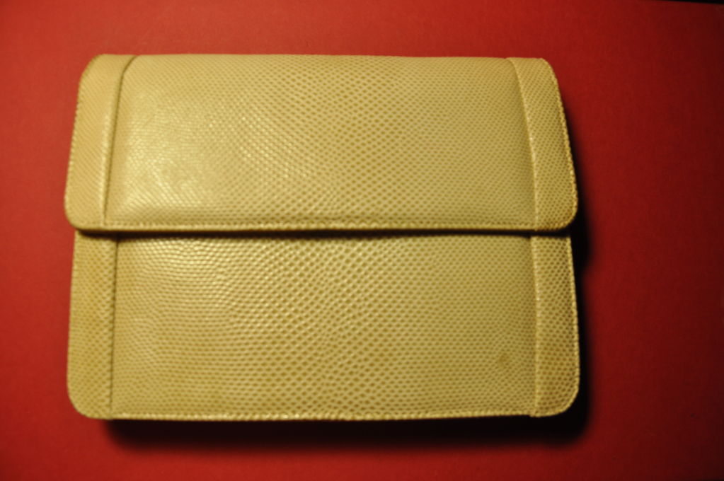 "This Jay Herbert lizard clutch in fawn color is lined with suede lining. The clutch measures 8 1/2"" wide, and 6 1/2"" in height. The clutch also comes with detachable shoulder straps."
