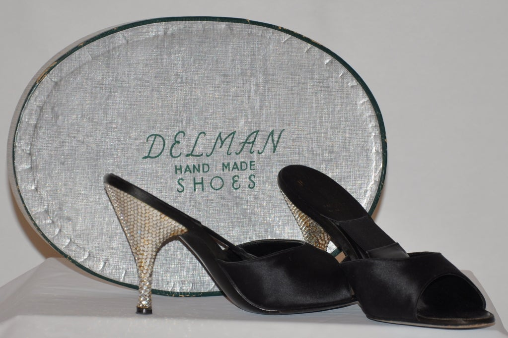 "These wonderful Hand-made Delman evening sandals have a ""spring-leather"" sole build inside for added comfort. The 4"" heels are embellished with rhinestones detailing. The material of the sandals are black silk satin. The sandals comes in its own"