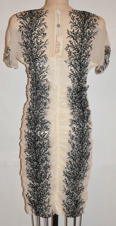 Alma fully lined white silk chiffon dress has stenciled velour black