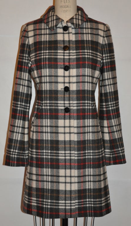 Ages B. wool plaid print fully lined coat is lightweight with two front set-in pockets. The plaid coat is in shades of charcoal, gray, winter white, red and browns.The front has five buttons closure. The center back of the coat has a center slit