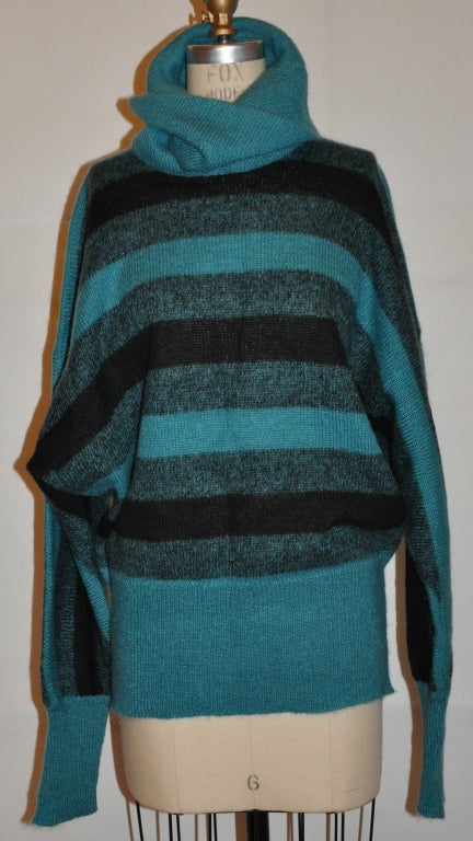 """Pierre Cardin 'Chez Hauber' Turquoise and black stripe turtleneck pullover sweater has a extreme high turtleneck for a more dramatic effect. The front measures 25"""", back is 26 1/2"""", the turtleneck height is 8 1/2"""", circumference is 24"""" unstretched."""