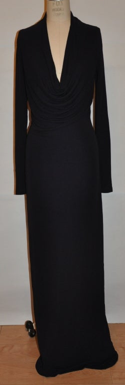 "Donna Karan Dark Plum jersey body-hugging cocktail gown has a plunging front neckline which hangs gracefully and elegantly. The front length measures 56"", back is 60"", back collar height is 4 1/2"", sleeves are 27 1/2"", circumference is 8"