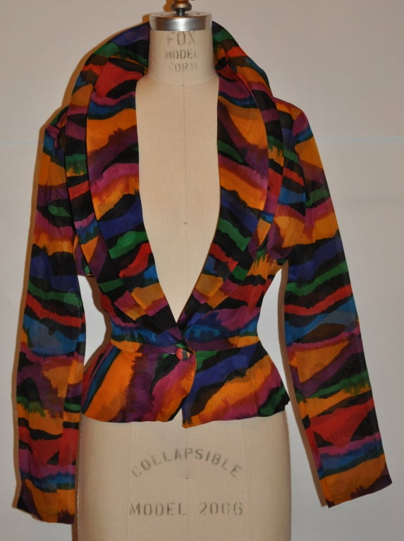 """Missoni Abstract multi-colored silk organza blouse has a single button front closing and peplum styled waist. The double collar makes for a more dramatic effect. The waist measures 30"""", underarm-to-hem is 13"""", underarm-to-underarm circumference is"""