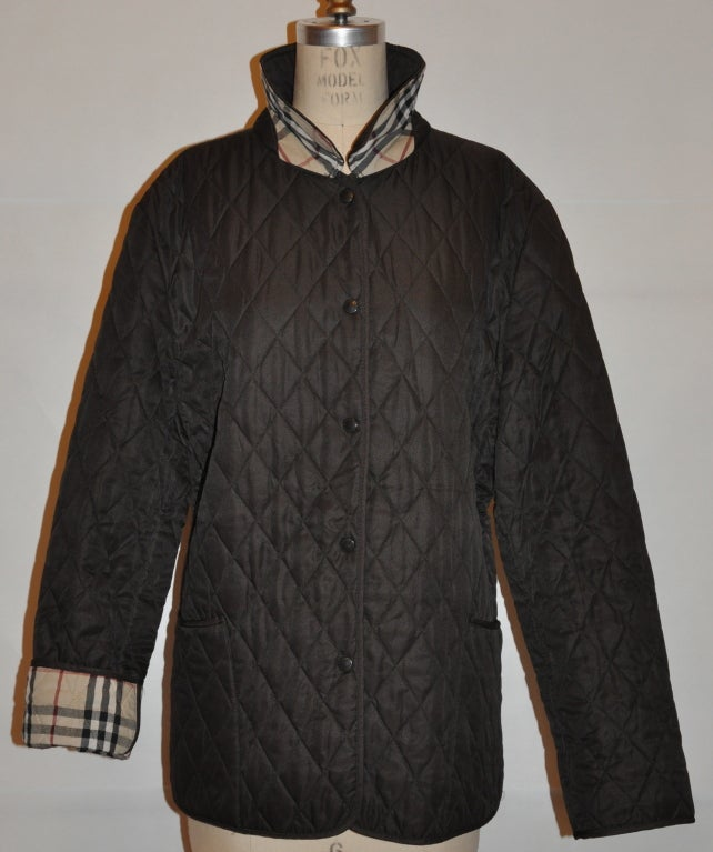 Burberrys Coco-brown quilted jacket has five front snap buttons for closing. The sleeves can be worn cuffed or uncuffed however you desire. The interior has their signature