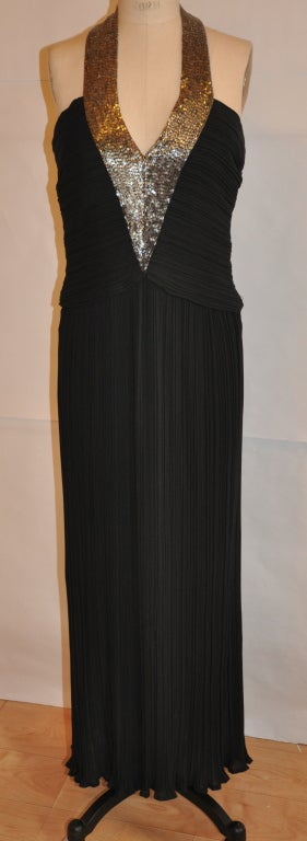 Alfred Bosand Black fully-lined pleated dress has detailed silver glass micro beadwork in front and along the neck. The gown has a center back invisible zipper which measures 13